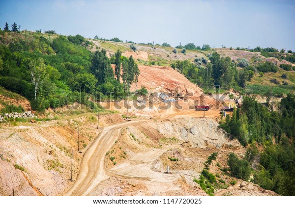 Limestone quarry, adjacent to the village. Mining industry
