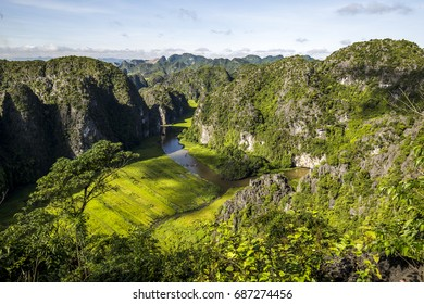 Limestone and rice fields in Ngo Dong river - Tam Coc - Bich Dong - Ninh Binh province of Viet Nam