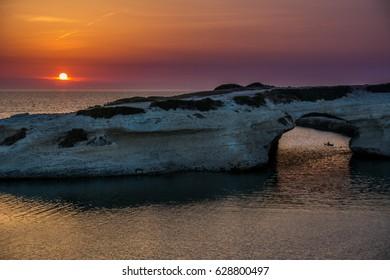 Limestone rock with arch, S`Archittu di Santa Caterina in Oristano Province, Sardinia, Italy captured in summer at sunset.