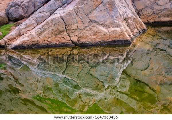 limestone-rock-mountain-reflected-dirty-