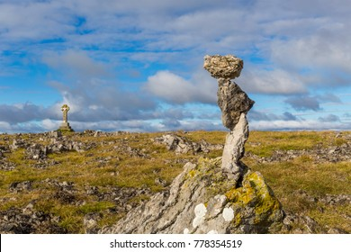 Limestone Rocks Carefully Balanced on Top of Beacon Hill near Orton in Cumbria, England, UK.