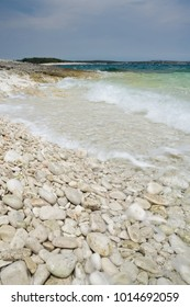 Limestone rocky coast with waves, Istria peninsula, Croatia