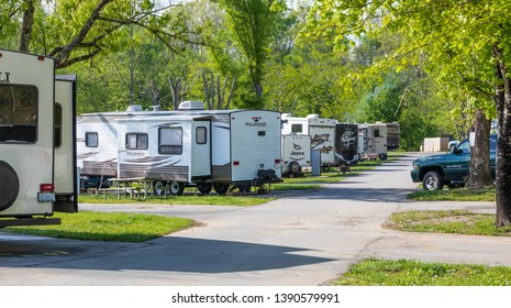 LIMESTONE, TN, USA-4/26/19: A row of camping trailers in an RV park on a sunny spring day.