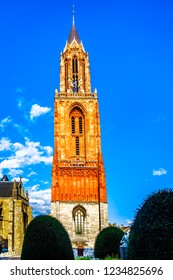 The limestone tower of the gothic Sint Janskerk in the historic city of Maastricht. Now painted, it was originally done with ox blood. In the 1200s it was the baptistery for Basilica of St. Servatius
