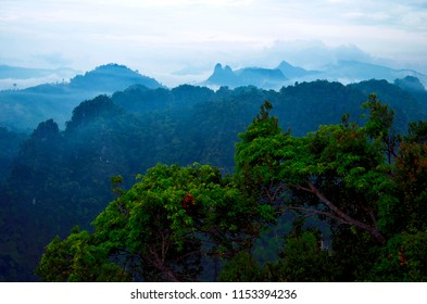 The limestones cliffs of Krabi under an overcast sky seen from the wat Tham Sua