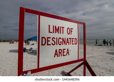 LIMIT OF DESIGNATED AREA WARNING SIGN AT THE BEACH