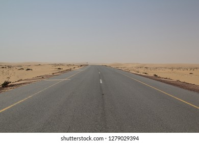 Limitless road through dunes in the desert of the Sulanate of Oman
