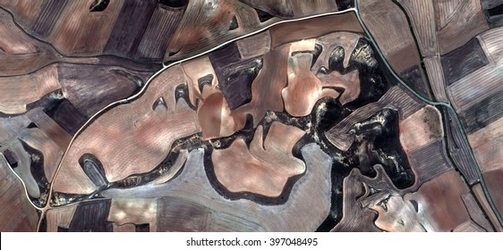 limits,allegory, tribute to Picasso, abstract photography of the Spain fields from the air, aerial view, representation of human labor camps, abstract, cubism, abstract naturalism,