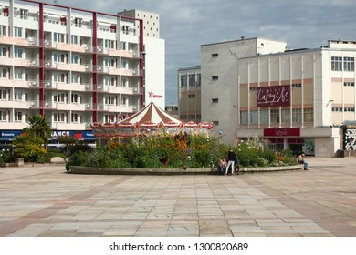 Limoges, France - September 28, 2017: The new district and houses (residential building) with an area with a large flowerbed (flowered bed) vacationers and citizens.