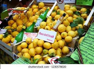 Limone, Garda/ Italy - 05/17/2017: street market with fresh lemons and Limoncello in Lemone. A sign do not touch!