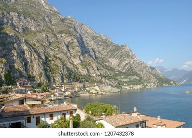 LIMONE, ITALY - SEPTEMBER 20: fall sun lightens roofs and lakeside of historical touristic village on Garda lake, shot in bright fall light on sept 20, 2018 at Limone, Italy