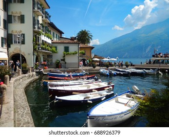 Limone, Lake Garda, Italy - May 2017: Small boats float in the pretty harbour