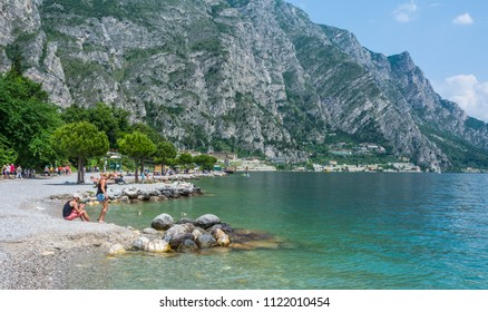 LIMONE SUL GARDA, Brescia, Italy - May 31, 2018: People at the beach, Limone sul Garda, Lake Garda, Brescia province, Lombardy, Italy, Europe