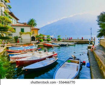 Limone sul Garda, Italy - September 21, 2014: The boardwalk with houses and boats
