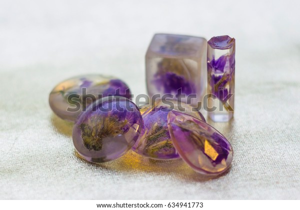 Limonium flowers and inside of crystals made of epoxy resin close-up with bokeh on background shallow depth of field