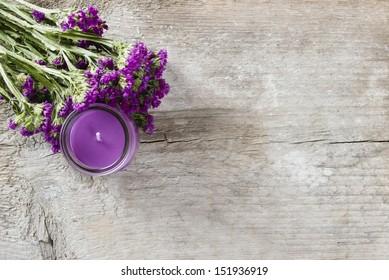 Limonium sinuatum, commonly known as wavyleaf sea-lavender. Statice flower, mediterranean plant on wooden background.