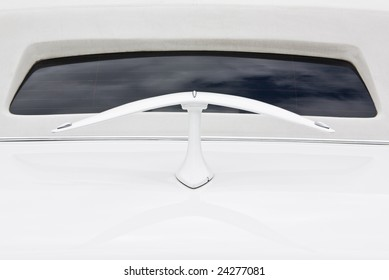 Limousine closeup from the back side with reflection of the cloudy sky in the back window and with decoration on cover