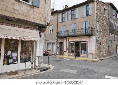 Limoux, Aude, France 06/16/20 Cross roads with shops at the intersection. Old town buildings with shuttered windows