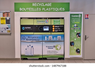 Limoux Aude France 08 26 19 Automated plastic bottle recycling machine in french shopping mall. Cartons are inserted into the round hole and deposited on containers below. A money voucher is printed.