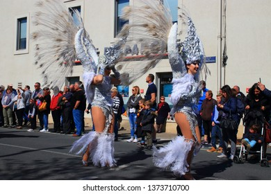 LIMOUX, FRANCE-MARCH 30, 2019: Angels parade at the french carnival of Limoux in Aude, Occitania in the southern of France