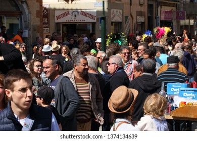 LIMOUX, FRANCE-MARCH 30, 2019: Crowd of people at the carnival of Limoux in Aude, Occitanie in the south of France