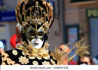LIMOUX, FRANCE-MARCH 30, 2019: man with a Venetian mask at the carnival of Limoux in the Aude, Occitanie in the south of France