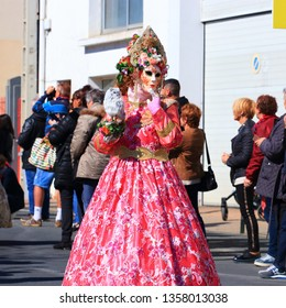 LIMOUX, FRANCE-MARCH 30, 2019: woman with a Venetian mask at the carnival of Limoux in the Aude