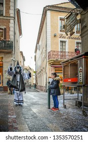Limoux,France March 2019.Canival with young boy looking at clown dancing in city center