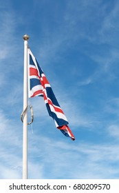 Limp Union Jack flag of the United Kingdom.