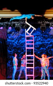 LINCOLN, CA - JAN 20: The Chinese Acrobats Of Hebei perform chair balancing at Thunder valley Casino in Lincoln, California on January 20, 2012