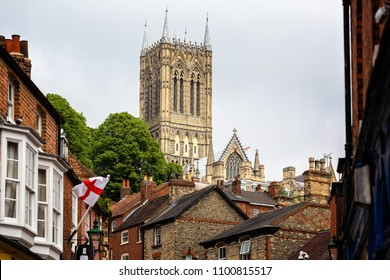 Lincoln Cathedral tower from the bottom of Steep Hill taken in Lincoln, East Midlands, UK on 23 May 2018