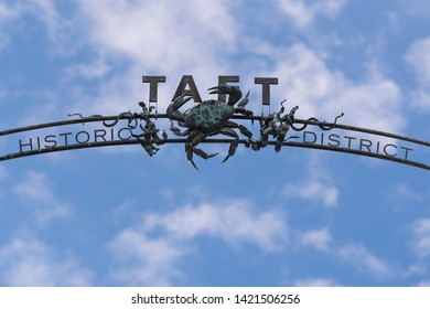 Lincoln City, Oregon - June 6, 2019: Old wrought iron arched sign identifying the historic fishing Taft District of Lincoln City, Oregon.
