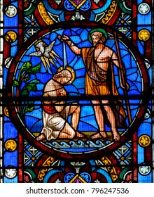 Lincoln, England - Nov 16, 2017: Close up E of Great East Window in Lincoln Cathedral, Stained Glass made by Ward and Hughes (1855); Baptism Of Jesus Christ By John The Baptist