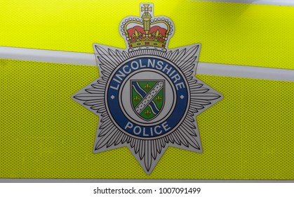 Lincoln, England - Nov 17, 2017: Close up of Lincolnshire Police Badge, Coat of Arms on Police Car