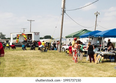 Lincoln, IL  USA - June 19th, 2021: Shot taken of people attending Lincoln, IL second Juneteenth event held at the local fairgrounds. Venders and speakers were there along with music being played.