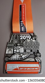 """Lincoln, Lincolnshire, England, UK - April 7th 2019: Finishers medal from Asda Foundation """"Run For All"""" Lincoln 10k 2019 running race"""