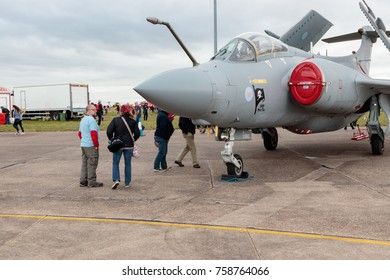 LINCOLN, LINCOLNSHIRE, UNITED KINGDOM - September 10, 2017: Unidentified people and a Blackburn Buccaneer, owned by Hawker Hunter Aviation, in the static display at the RAF Scampton Airshow