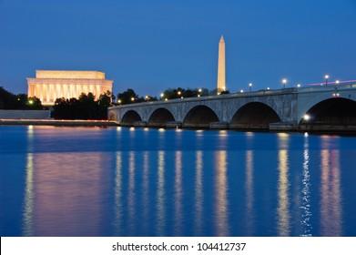The Lincoln Memorial, Arlington Memorial Bridge and Washington Monument reflected in the Potomac River at dusk. Washington, DC