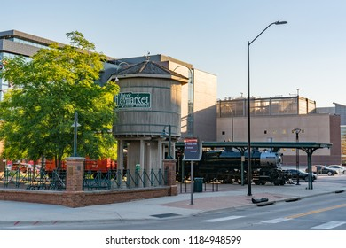 LINCOLN, NE - JULY 10, 2018: Railroad locomotive and water tower in the historic Haymarket District of Lincoln, Nebraska