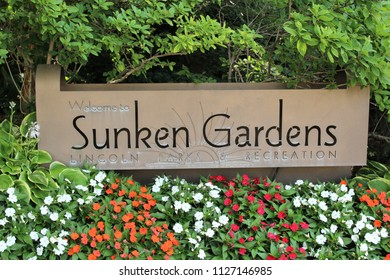 Lincoln, Nebraska/United States of America - July 4, 2018: Sunken Gardens entrance sign with flowers in foreground