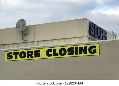 LINCOLN PARK, MICHIGAN-NOVEMBER 8, 2018-Signs on a local Sears store indicating they are going out of business. Sears was once America's largest retailer.