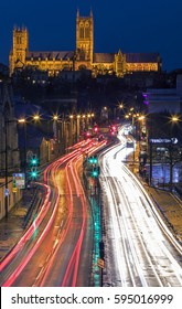 LINCOLN, UK - FEBRUARY 2017: A view of Lincoln Cathedral overlooking light trails from traffic in the historic city of Lincoln, in the UK, on 27th February 2017.