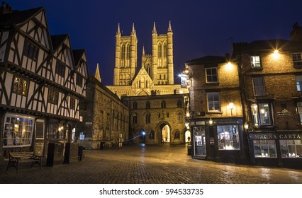 LINCOLN, UK - FEBRUARY 28TH 2017: Lincoln Cathedral viewed from Castle Hill in Lincoln, UK, on 28th February 2017.  Exchequer Gate, the Magna Carta public house and Pemberton House can also be seen.
