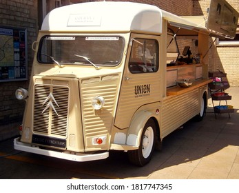 Lincoln UK  July 3 2015: A vintage style take away food van parked outside the railway station.