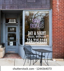 LINCOLNTON, NC, USA-11/25/18: Bail Bonds office with table & chairs in front.
