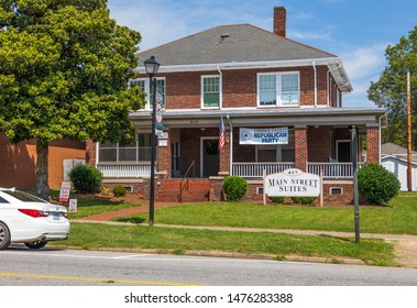 LiNCOLNTON, NC, USA-9 AUGUST 2019: An old house on main street, converted to offices, and the home of the Lincoln County Republican Party.