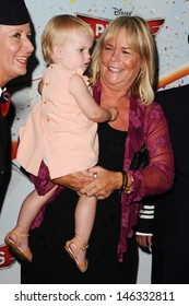 """Linda Robson with granddaughter arrives for the """"Disney Planes"""" premiere at the Odeon Leicester Square, London. 14/07/2013"""