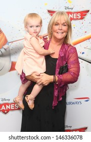 """Linda Robson with her granddaughter arrives for the """"Disney Planes"""" premiere at the Odeon Leicester Square, London. 14/07/2013"""