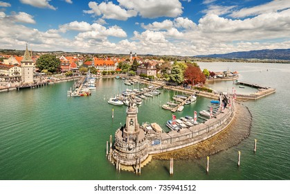 Lindau, Gegmany - May 5, 2017: Aerial view of the german port Lindau including Mangturm tower and a lion statue.