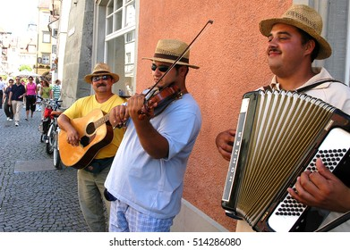 LINDAU, GERMANY - AUGUST 19, 2006: Buskers on the main street of the city